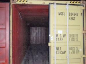 Tom, åben container m. synligt containernummer